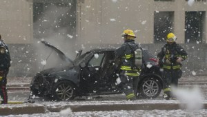 Vehicle catches fire in downtown Winnipeg, crews put out flames